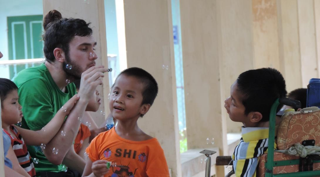 A male intern is pictured hard at work during his speech therapy internship in Vietnam, Asia with Projects Abroad.
